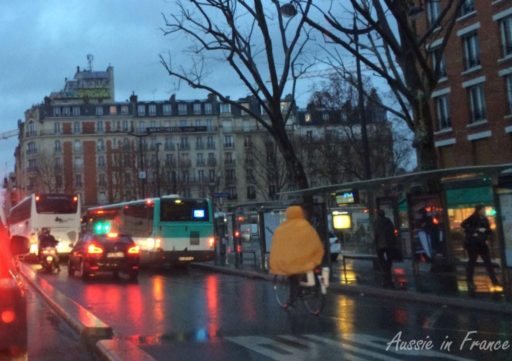 Rainy streets of Paris at sunrise
