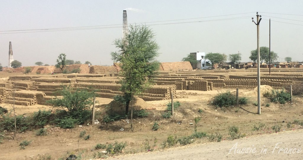 Brick factories and stocks on the road to Agra