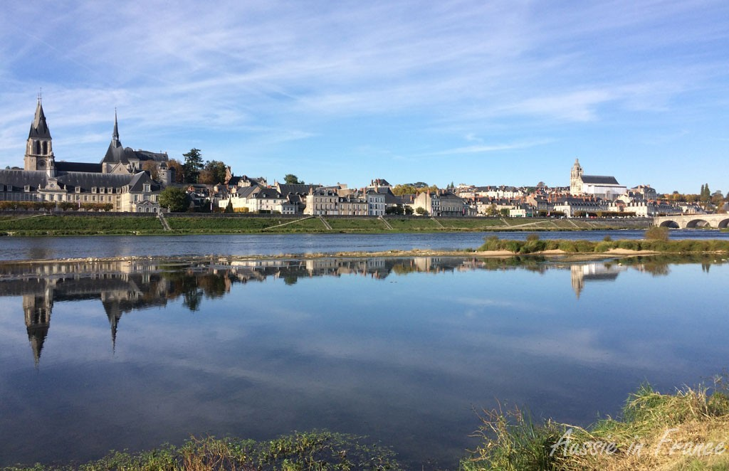 The castle and cathedral reflected in the Loire