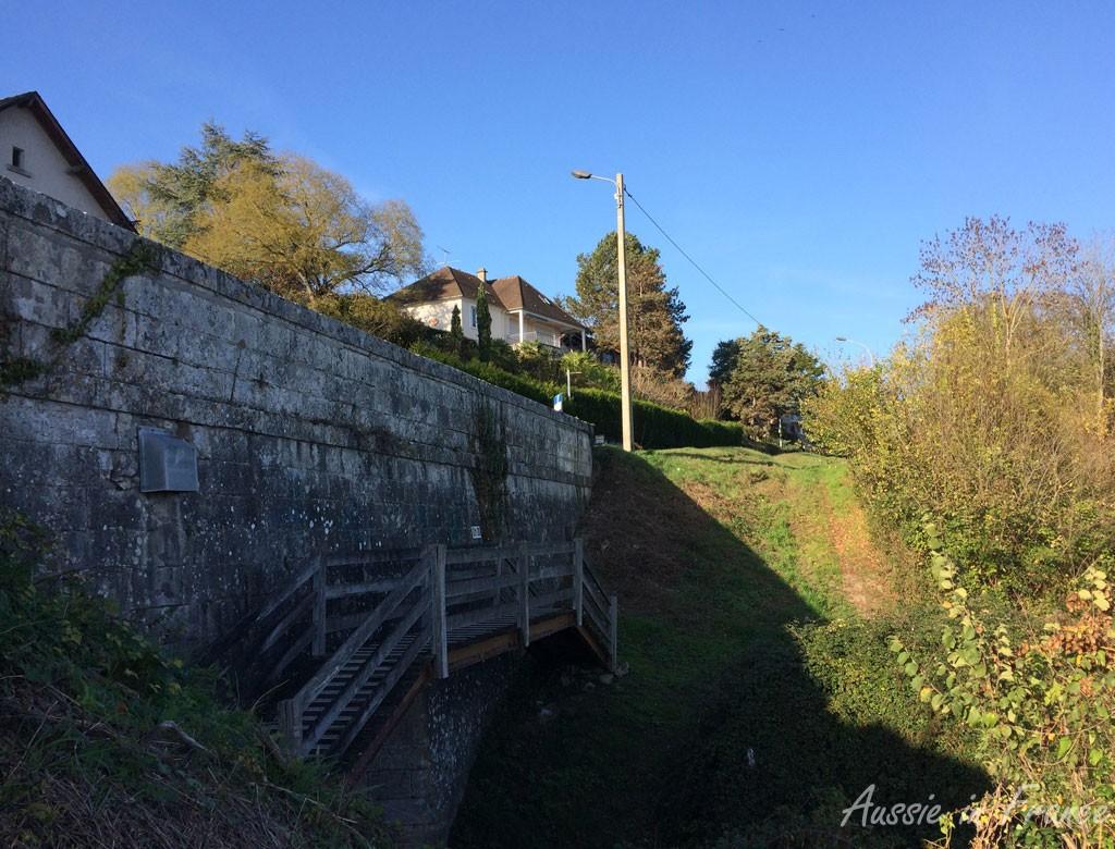 The wooden bridge next to the culvert