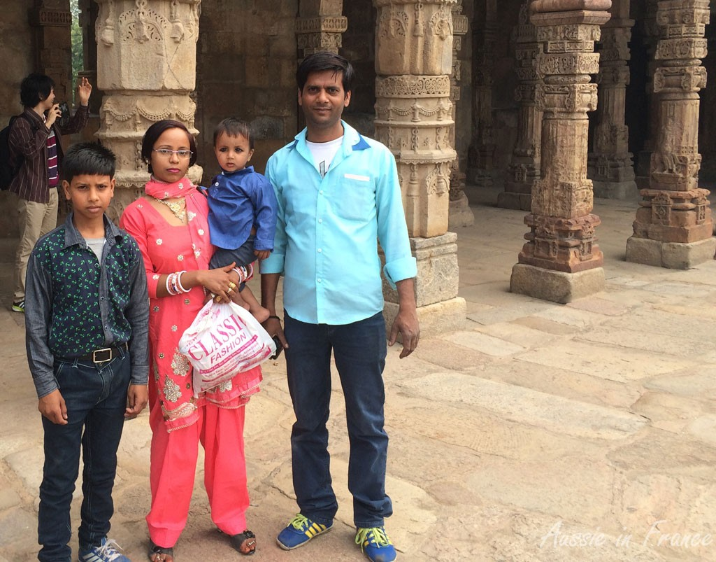 An Indian family at Minar. I find the little boy's black eyes very worrying.