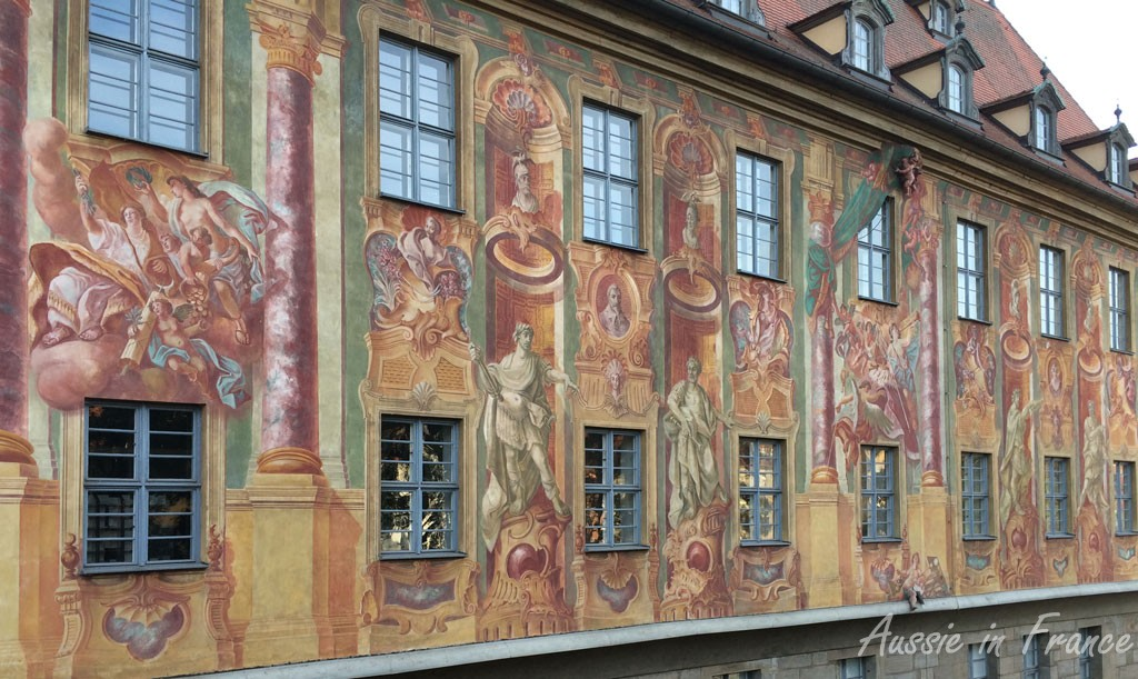 The frescoes on the wall of the Altes Rathaus. Have a close look on the right bottom.