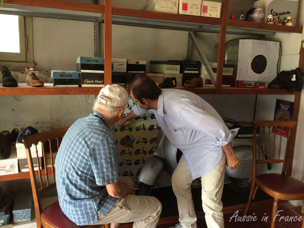Jean Michel and the bootmaker discussing Vespas