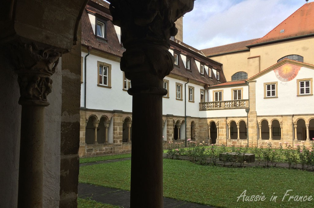 The cloisters of the Carmelite Monastery with their finely carved capitals and painted sundial