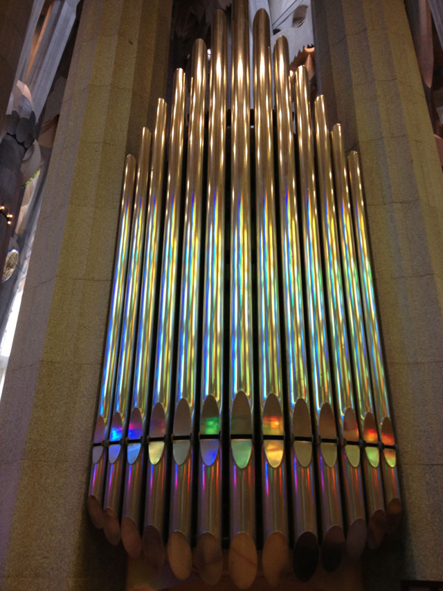 Organ reflecting the colours from the stained glass windows