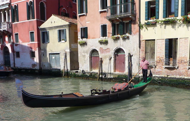 Alessio, our gondolier, coming to meet us