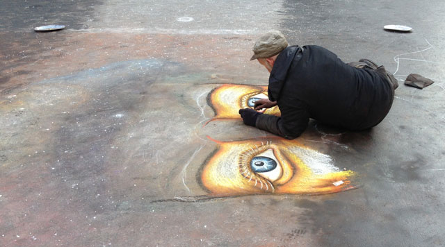 Pavement artist on Place du Palais Royal at 1°C.