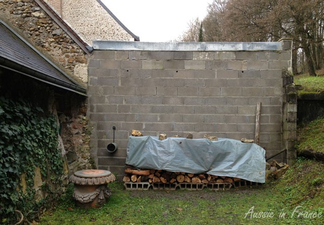 The woodpile at the back against the ugly wall that is waiting to be rendered ...