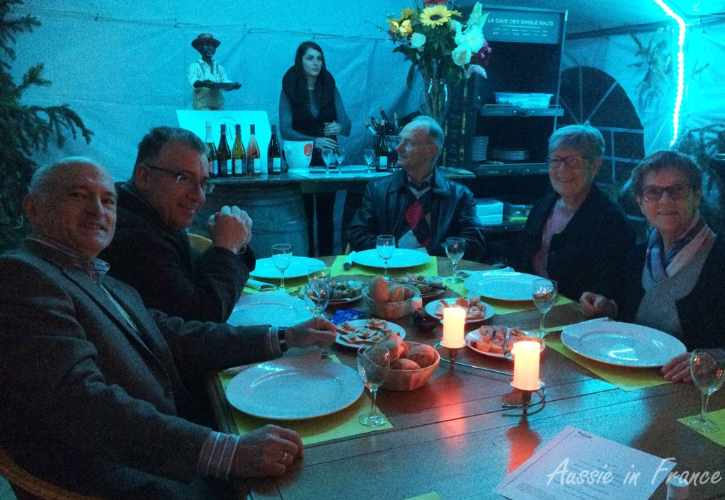 Sharing an appetizer platter inside Eric Bacon's tent