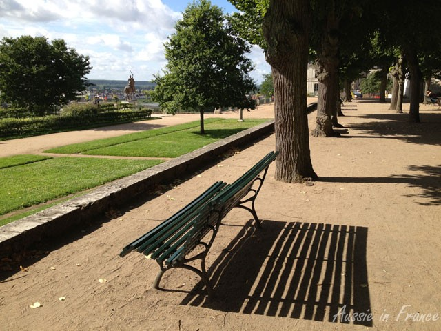 A bench casting shadows in Jardin de l'Evêché in Blois