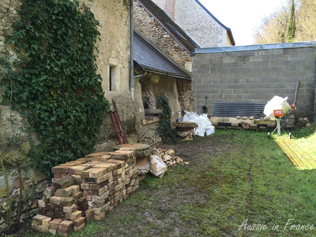 """The bricks unloaded. You can see the stone sills at the end of the garden. The """"practice"""" window is the last one on the right."""