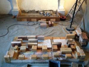Bricks arranged like miniature Roman bath ruins
