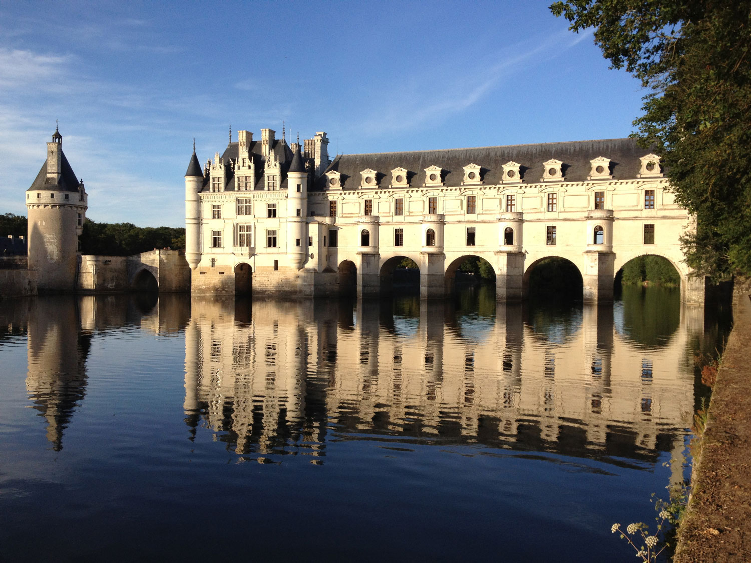 Chenonceau reflected in the Cher at dusk