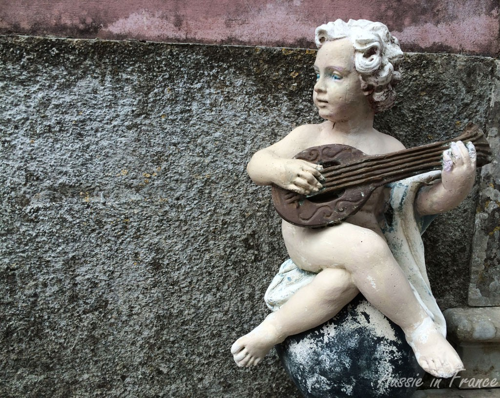 A little cherub on the road up to the restaurant