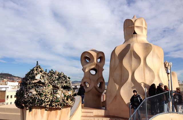 Chimneys on top of La Pedrera - the one on the left is covered in broken glass from champagne bottles