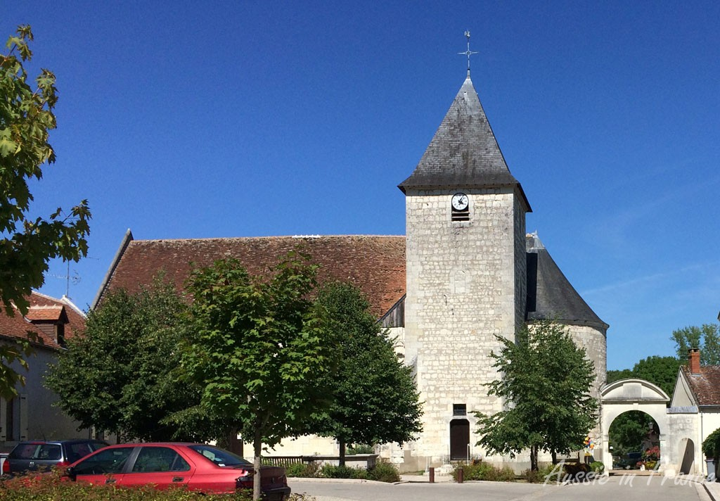 The church with its unusual archway in Pouillé