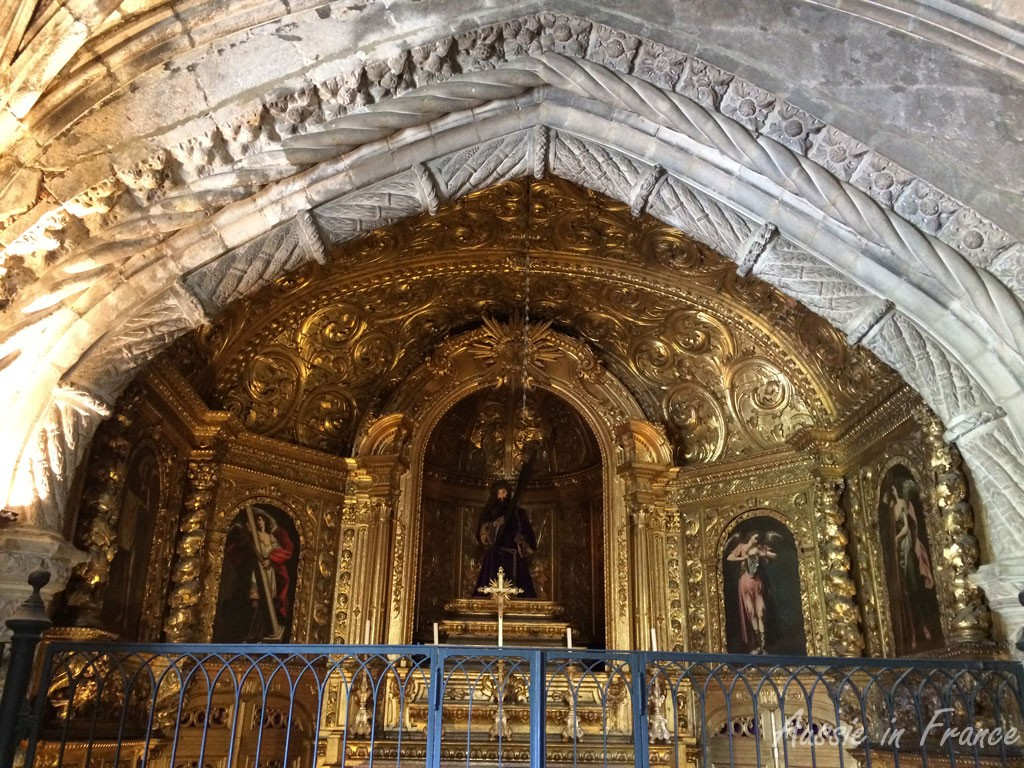 The intricate gold altar on the right as you go into the church