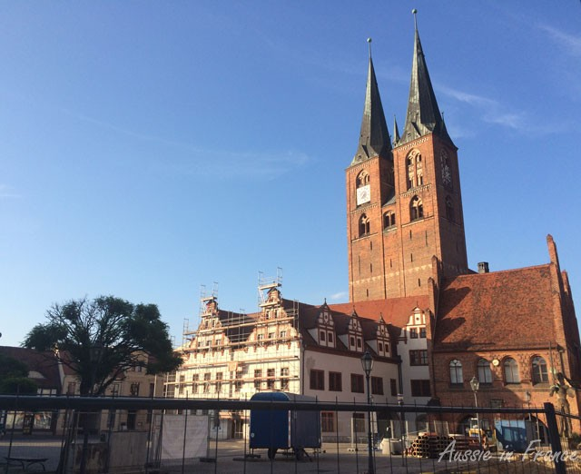St Jacob''s Gothic cathedral in Stendal with the rathaus in front