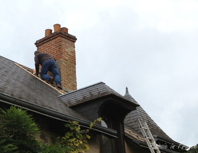 Mr B. climbing up the roof with his spray cans