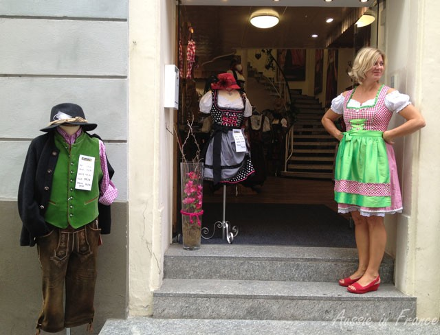 A traditional clothes shop in Austria with a traditional sales assistant