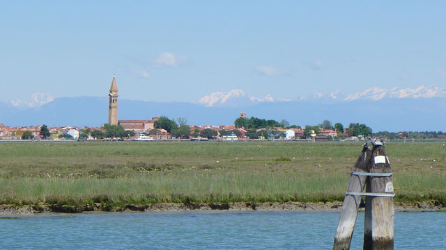 The marshland between Treporti and Erasmo Chiesa with Burano and the snow-capped peaks of the Dolomites in the distance