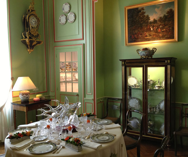 The family dining room with its matching table cloth and porcelain with the family arms