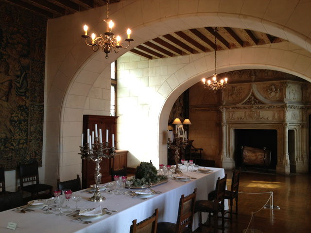 The dining room with its Gothic fireplace