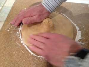 Forming a circle from the ball of dough