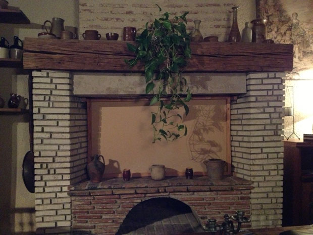 Our boarded-up downstairs fireplace