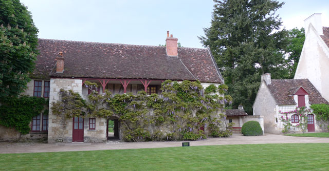 16th century farm at Chenonceau with wisteria and climbing roses in bloom
