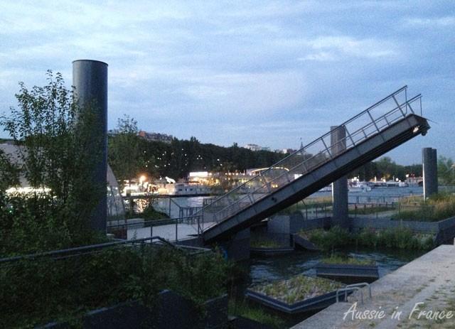 Raised footbridge across to the floating gardens