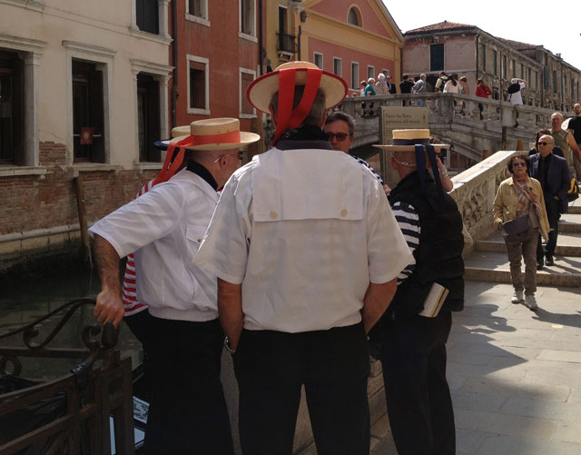 Gondoliers in their traditional garb