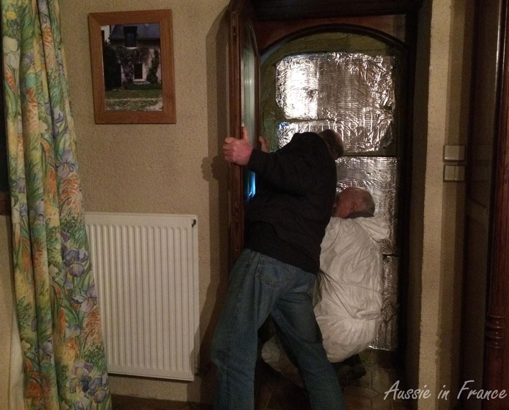 Alain arrives just in time to help Jean Michel hang the door
