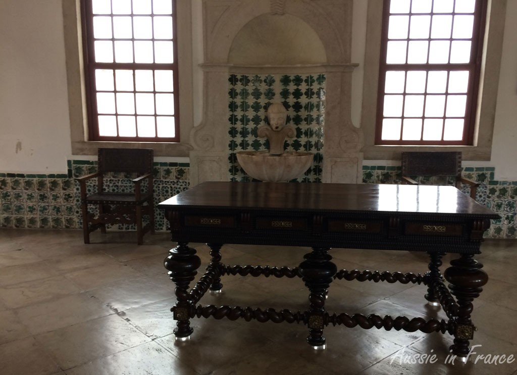 Henri II table with azulejos in the background