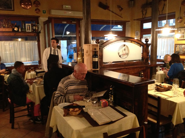 Jean Michel examining the menu at Hosteria al Vecio Bragosso