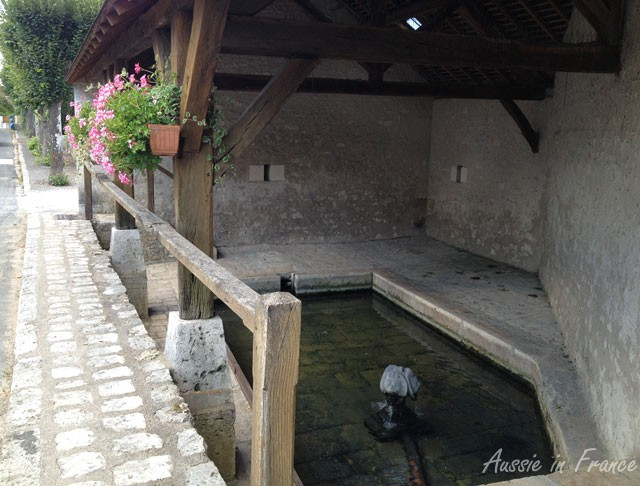 A lavoir with an interesting fountain head in Valliers les Grandes