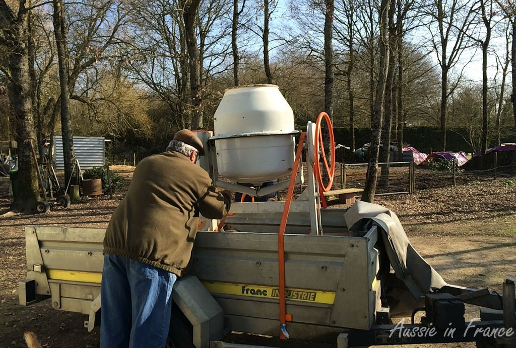 Getting the cement mixer onto the trailer