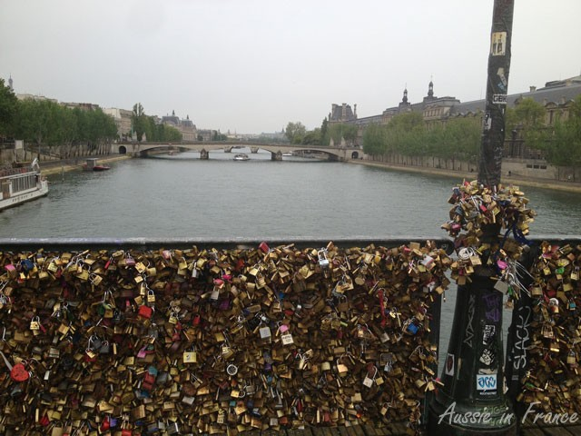 Ponts des Arts weighted down with lovelocks now crawling up the lamp posts