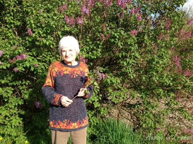 The little old lady in front of the lilac bush