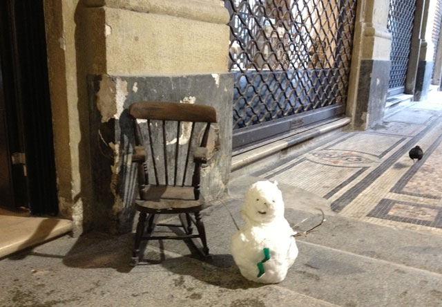 A miniature snowman in front of Miss Bibi's