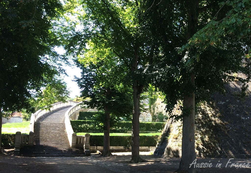 The monumental staircase opposite the collegiate church leading up to the château
