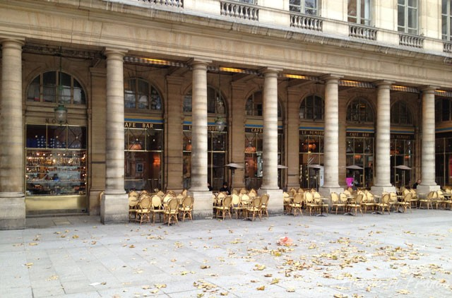Autumn leaves in front of Café Nemours on Place Colette