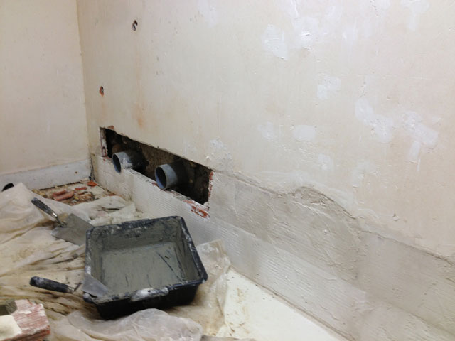 The plaster wall after filling with bricks and plastering