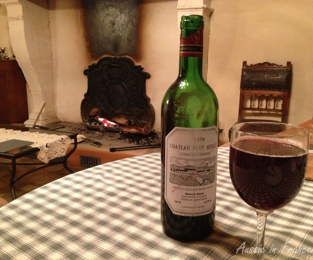 One of our favourite bordeaux - a 1979 Saint Emilion, with the fireplace and Henri II leather covered chair in the background.