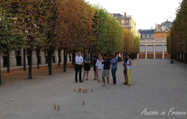 People in the Palais Royal Gardens playing an unknown game