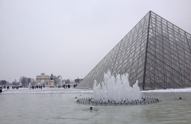 The Louvre pyramid with the water iced over