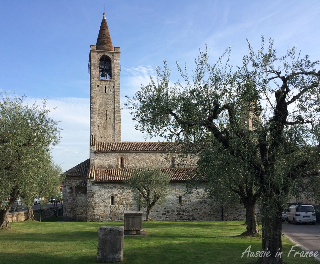 The Romanesque church of San Severo with its olive trees