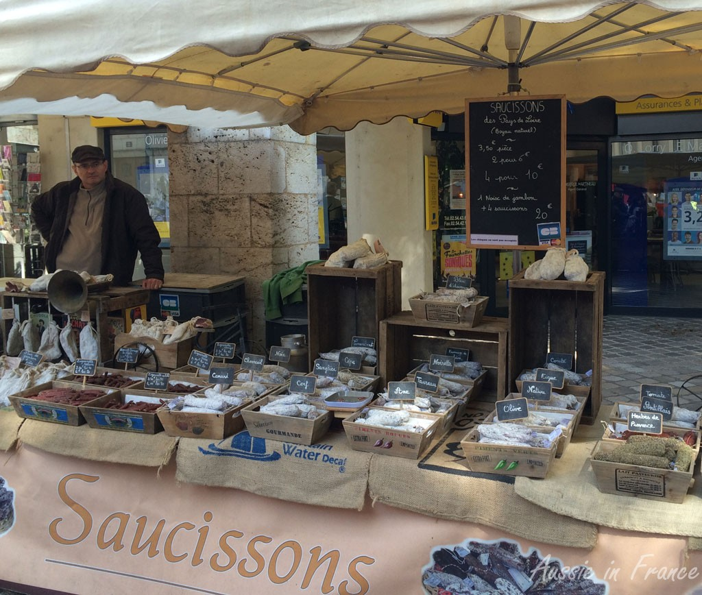 The saucissons vendor on the market with local varieties such as deer and wild boar.