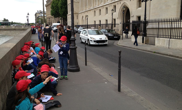 French children on a school excursion drawing the law courts opposite