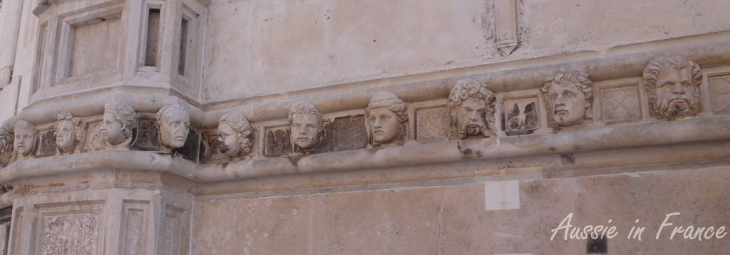 Some of the sculpted heads on Saint James' cathedral